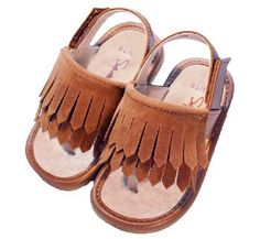 Amazing take on moccasins! Love the fringe. Perfect for a little Native American costume/outfit! Little Green Trike Co: Cheyenne Tan Sandal - Toddler Girl Squeaky