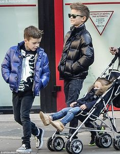 Family fun: Romeo was seen exploring the French capital with Harper and Cruz