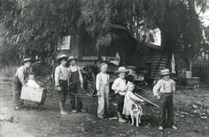A group of children are shown playing near the Simi Colony in the 1890s.