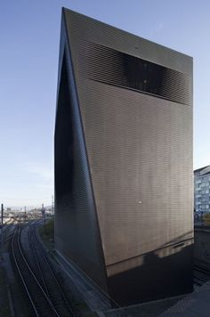 Rail Switching Station: Wrapped in copper ribbon to act as a Faraday cage. Herzog & De Meuron
