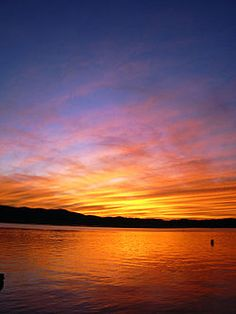 Sunset in Knysna, South Africa, displaying the separation of orange colors in the direction from the sun to the observer and the blue components scattered from the surrounding sky.