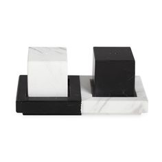 Culinary CubismOur Canaan Salt & Pepper Shakers add style to your seasoning.Crafted from black and white marble, the shakers come on a plinth base you'll want to leave out as a miniature sculpture. The pared down and polished mix packs maximum style into a minimal footprint. Stow the coordinating color in its place or mix it up and show off your spicy side.