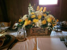 Beautiful floral centerpiece that incorporated lemons and monarch butterflies