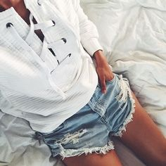 Spend those lazy summer days in cut-off denim shorts and lace-up tops #AsSeenOnMe