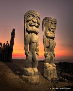 Two Tikis At Sunset by Yves Rubin. Two Tiki warrior statues carved from wood protecting the Hale o Keawe Heiau at the Place of Refuge, Pu'uhonua O Honaunau National Historical Park, Big Island of Hawaii.
