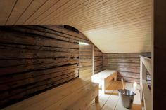 The interior fittings were fashioned from local spruce, and the wood-burning stove was built by the Mr. Lassila himself—'brick by brick,' he says. The sauna cost around $20,300.The contrast between the new and old wood is echoed in his new house, which uses clashing materials like aluminum, wood and concrete.