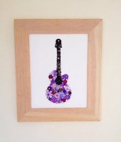 Custom sparkly button guitar. Message me if you'd like me to make you a custom picture. Www.facebook.com/sarahsbuttonpictures