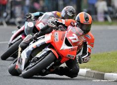 Ryan farquar chased by conor cummins at north west 200 in 2010
