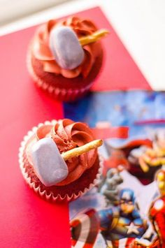 These Thor cupcakes are a red velvet cake and topped with a red velvet frosting. Thor's hammer is made of pretzels and fondant that's been brushed with luster dust. These are a fun and simple Avengers cupcake to make for any fan's birthday party. #avengers #cupcakes #redvelvet #frosting #buttercream #Thor