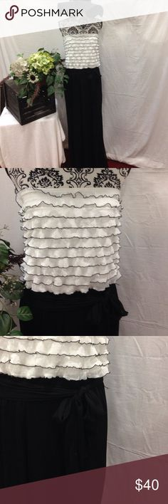 Connected Apparel Blk/White Jumpsuit Size large. Connected apparel. Black and white.  Chiffon sash. Ruffles tiered bodice. Strapless. Wide legs. No flaws. Free gift Connected Apparel  Pants Jumpsuits & Rompers