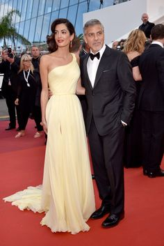 "Amal and George Clooney at the premiere of ""Money Monster""at the Cannes Film Festival. Amal Clooney wears Atelier Versace."