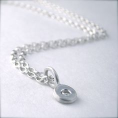 Tiny Dot Sterling Silver Moissanite Pendant by panicmama on Etsy, $65.00