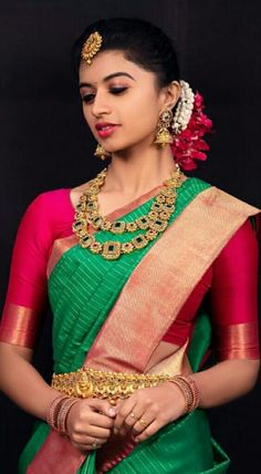 0c988cdd1e South Indian bride. Indian bridal jewelry.Temple jewelry. Jhumkis. Red and  green