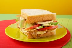 The Big Apple: Thick slices of bakery style white bread with Smooth Operator peanut butter and apple jelly stuffed with dried apple wedges and freshly sliced red and green apples.