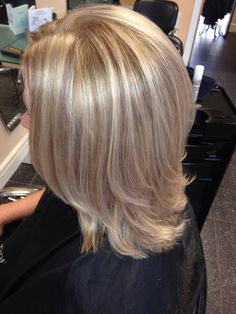 Perfect blonde high lights and brown mocha low lights shoulder length hair cut