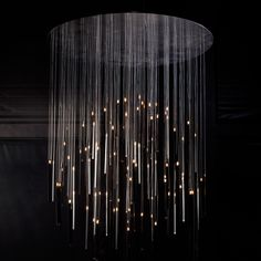 "Candle In the Wind, a chandelier of high-tech candles with LED ""flames,"" by Ingo Maurer and Moritz Waldemeyer."