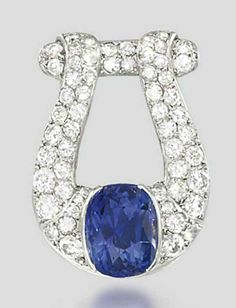 AN ART DECO SAPPHIRE AND DIAMOND CLIP BROOCH Designed as a pavé-set circular-cut diamond buckle plaque mounted with a cushion-shaped sapphire, circa 1930, 2.9cm long