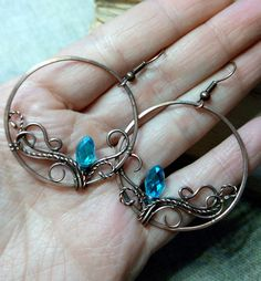Handcrafted wire wrapped earrings with blue glass. Elegant and light circle earrings with very unique pattern Covered with special lacquer to protect it from influence of oxygen. materials: copper, glass beads size: 1.5 inches (37 mm) box included)