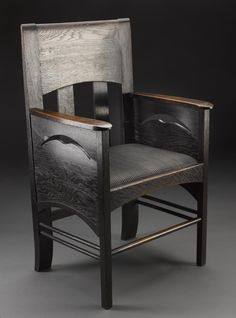 Dark-stained oak armchair with panelled sides, pierced with a flying bird motif, and a drop-in seat of woven rush covered with chequered horsehair. From the Argyle Street Tearooms, Glasgow, designed by Charles Rennie Mackintosh, 1898. Made at the workshop of Francis Smith, Glasgow, 1898-99. Probably used in the ground floor rooms.