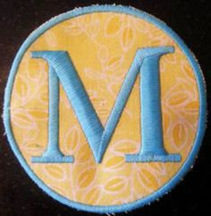 Applique patch made with Badegmaster water soluble stabilizer, fabric and heavyweight tearaway floated under the hoop. Can't hoop? No problem!