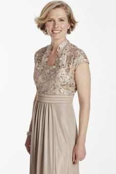 Modern lace tank bodice with matching cap sleeve jacket.  Modern lace tank bodice with matching cap sleeve jacket.  Long Metallic jersey skirt makes this an elegant mother of the bride dress.  Designed by Emma Street.  Fully lined. Center back zip. 95% Polyester, 5% Spandex. Professional dry clean.
