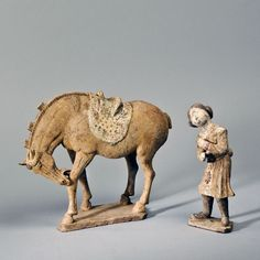 A&J Speelman Oriental Art | Chinese | Early Ceramics | An unglazed terracotta horse with raised neck and head, together with a seated foreign groom