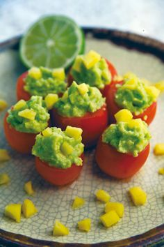 Guacamole Stuffed Tomato Poppers | Healthy & SCRUMPTIOUS! | 6 GRAM FIBER to boot! | You'll never want another APP again! | From The Nutrition Twins Veggie Cure book! Enjoy! :) http://www.amazon.com/Nutrition-Twins-Veggie-Cure-Tantalizing/dp/0762784768/ref=la_B001IOBDZS_1_3?s=books&ie=UTF8&qid=1383689502&sr=1-3  |For MORE RECIPES please SIGN UP for our FREE NEWSLETTER www.NutritionTwins.com
