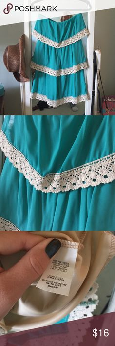 Teal strapless dress This dress couldn't be any cuter. 3 layers lined with cream colored lace. The teal color of the dress is so rich and beautiful. Comes with a built in liner. Purchased from a local boutique in my area called Bluetique Bluetique Dresses Strapless