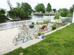 This coastal yard was completely barren except for an old, weathered boardwalk of a deck before its homeowner added a retaining wall, and gravel and slate patio for entertaining. Could you have imagined it thus?