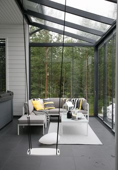 modern wooden Finnish house. Black and white. Marimekko.