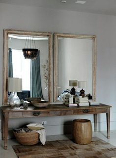 House call: Harriet Maxwell and Andrew corrie of Ochre in NYC. A pair of antique mirrors hangs over a vintage farm table in the dressing area. Soho Loft, Sweet Home, Turbulence Deco, Deco Boheme, Interior Decorating, Interior Design, Foyer Decorating, Decorating Ideas, Home And Deco