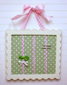 easily make this hair clip holder from a frame, ribbon, and fabric. Natalie needs one!