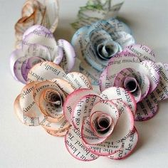 Pretty colorful Paper flowers unter We Heart It. colorful newspaper flowers roses diy