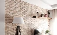 Resultado de imagen de salon con pared de ladrillos