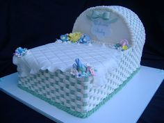 Green Baby Bassinet - 2 inch cakes stacked with a cake cut in half to make the hood of the bassinet. Covered in buttercream in a basketweave pattern, gumpaste flowers, fondant blanked and accessories. Baby Shower Cake Designs, Baby Shower Sheet Cakes, Baby Bump Cakes, Shower Cakes, Gateau Baby Shower, Baby Shower Sweets, Baby Shower Cookies, Bed Cake, Cake Design Inspiration