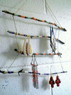 Here's a neat idea for jewelry display - just a few twigs, a little twine, and paint!
