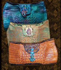 www.ifaniadesigns.com  Luxurious alligator and crocodile clutches with stunning jewels, artisan made in the USA by New Mexico artist Ifania.