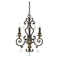 French Regency-style chandelier with crystal accents.  Product: ChandelierConstruction Material: Steel and crystalColor: Antique silver leaf and imperial bronzeFeatures: Multifaced crystal drop accentsAccommodates: (3) 60 Watt B10 candelabra base bulb - not includedDimensions: 21 H x 17 Diameter