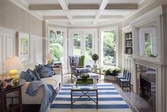 If we ever remodel the family room, I want these windows. (Blue and white family room by Weaver Design Group)