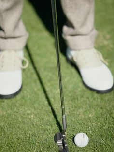 Low Section View of a Man Putting a Golf Ball Photographic Print at AllPosters.com