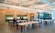 Plywood walls. Mismatched chairs. Collaborative tables.. By o plus a