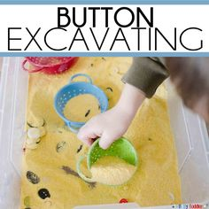Create a simple Button Excavating sensory activity for your toddler. Toddlers will love this easy digging activity using buttons, corn meal, and colanders. Tap the link to check out fidgets and sensory toys! Indoor Activities For Toddlers, Gross Motor Activities, Montessori Activities, Infant Activities, Activities For Kids, Space Activities, Educational Activities, Toddler Sensory Bins, Sensory Boxes