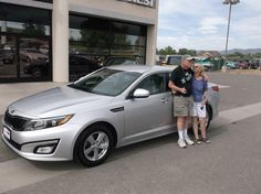 Louis and Sherry' new 2014 KIA OPTIMA! Congratulations and best wishes from Grand West Kia and Tom Matelski.
