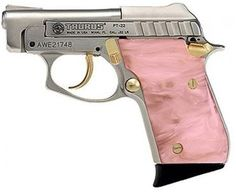 Taurus Small Frame 22 LR Pistol in Nickel W/Gold Highlights Finish.well ain't that sweet! A purty, pink pistol. Revolver, 22 Pistol, Pink Pistol, Pink Guns, Long Rifle, Everything Pink, Guns And Ammo, Weapons Guns, Concealed Carry