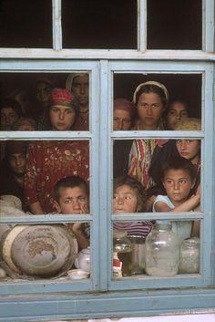 Shogara, Tajikistan. 1993. Refugee camp outside village mosque, after civil war of winter '92.  [Credit:Abbas]