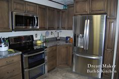 Chrome appliances and maple cabinetry!
