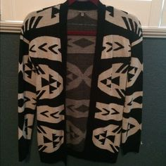 Tribal printed cardigan Wore this a few times when I first bought it but since then just sits in my closet. Warm black and white tribal printed cardigan. No rips or tears. Charlotte Russe Sweaters Cardigans