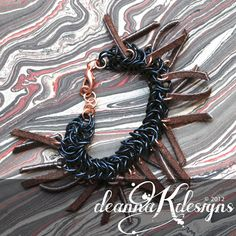 "Chainmaille ""Caterpillar"" Bracelet - Anodized aluminum, copper, leather - Copyright 2012 DeannaKDesigns"