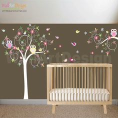 Swirl Tree Decal Set includes:    swirl tree with flower and polka dot pattern leaves 74h x 55w  swirl branch 36w x 18h  10 Birds  3 Owls      This