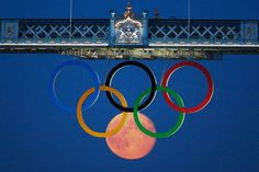 The full moon rises through the Olympic Rings hanging beneath Tower Bridge during the London 2012 Olympic Games #Malta #facebook #socialmedia HAVE YOUR SOCIAL MEDIA PROFILES LOOK LIKE MINE icandothing.com